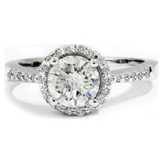 Halo #engagement rings are in. Center stone surrounded by a circle of smaller stones.
