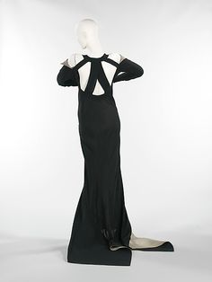 """Black silk """"Phèdre"""" gown (back) by Jeanne Lanvin, French, fall/winter 1933. Label: """"Mary Walls/Branch Shop/Waldorf-Astoria/South Lobby/East 45th St./New York"""""""