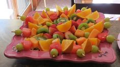 Pretty fruit platter, maybe heart shaped, with white choc dipping sauce?