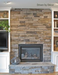 Fireplace makeover by covering ugly brick with stone veneer