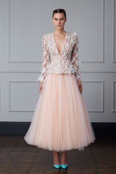 Turkish Designer Dilek Hanif's intricate couture works have been the secret of red-carpet stylists for years. We love the structure of her Spring/Summer 2015 Couture collection (reminiscent of Chanel collections from years past) and the sorbet shades of both the dresses and the adorning floral appliqués | WedLuxe Magazine #weddingcouture #designerdress
