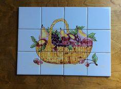 Basket of fruit and veggies on ceramic tile by Eastburnoriginals