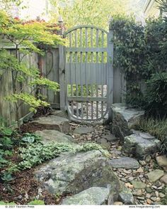 Dry Stream Does Double Duty using flat stepping stones | Fine Gardening