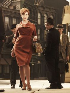The Faux Wrap Dress. By creating definition across the bust, the style slenderizes on top while camouflaging hips and tummy. http://www.ivillage.com/mad-men-style-dress-joan-holloway/5-b-107451#107455