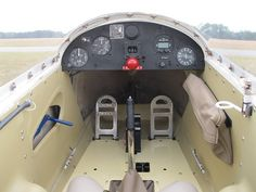 Schweizer SGS 2-33 cockpit. Red ball is the tow release knob. Blue lever on the left is the air brake. The vinyl pouch on the right is probably for charts and a radio.