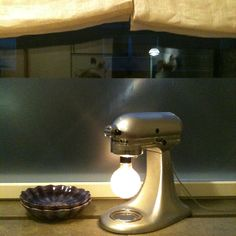 A bit of reuse and nostalgic connection. I excavated a Kitchenaid to make this lamp.