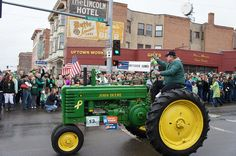Jon Tester waves to friends from the seat of a John Deere tractor during the St. Patrick's Day parade in Butte.