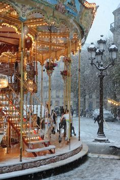 Merry-Go-Round at Sacre Coeur, Montmartre in the snow.