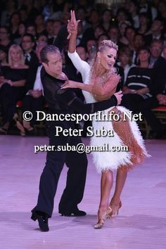 Yulia and Riccardo.  Love the feathers and her hair.