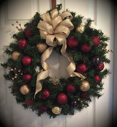 24 inch maroon & gold wreath, finished with gold trimmed bow