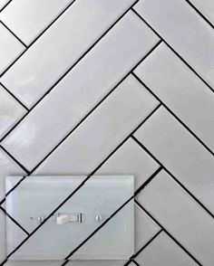 Beautiful Backsplash - The rest of the backsplash is white tiling that was cleverly placed into a herringbone pattern. Kristin says 350 tiles were used, with 191 cuts made!