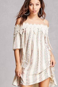 A woven dress featuring an alternating floral and paisley print in a stripped pattern, open-shoulder design, adjustable cami straps, short sleeves, a smocked back, crochet trim along the neckline and shoulders, and a swing silhouette.<p>- This is an independent brand and not a Forever 21 branded item.</p>