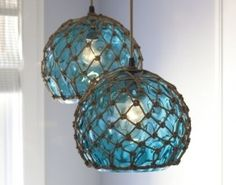 Coastal Pendant Lamps inspired by Fishing Glass Floats in Aqua Blue. DIY inspiration since Pottery Barn Teen no longer sells them.