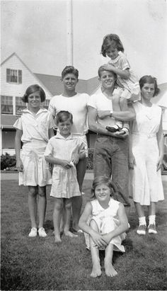 Eunice, Bobby, Joe Jr, Jack holding Jean, Rosemary, and Pat (sitting) in Hyannis Port. 1933