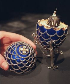 is a Faberge Egg named PINECONE and made in 1900 for Russian businessman Kelh ( Kelh was famous for ordering ten Faberge Easter eggs he presented to his wife starting in - this egg has a surprise - an elephant with a little man on it. Egg Names, Fabrege Eggs, Faberge Jewelry, Egg Designs, Egg Art, Egg Decorating, Russian Art, Pine Cones, Charms