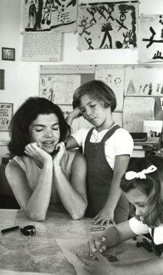 Jackie in Caroline's school room. She had converted an empty room on the third floor of the White House where Caroline attended first grade along with ten friends who were dropped off each day for classes.