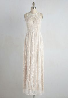 Draped in the dreamy white lace of this maxi dress, you'll be floating on cloud 'divine'. A beige underlay brings an earthy touch to this bohemian-inspired beauty, while a plunging illusion neckline and delicate, scalloped trim offer an allure that's simply sublime.