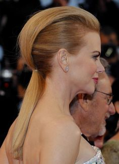 """Movie star Nicole Kidman wears her long hair in an edgy, interesting style called the """"Faux Hawk"""". This hairstyle mimics the shaved sides and long top of a real mohawk, Mohawk Hairstyles For Women, Pony Hairstyles, Celebrity Hairstyles, Straight Hairstyles, Gorgeous Hairstyles, Hair Styles 2014, Curly Hair Styles, Pelo Mohawk, Futuristic Hair"""