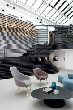 Arkwright offices by Haptic feature a slatted wooden staircase
