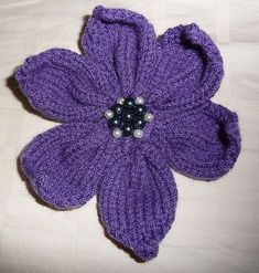 """A Knitted Flower (with pattern) (Goes to hat pattern """"Project Gallery for Poppy pattern by Justine Turner"""""""