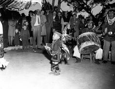 Hopi Indian dancer, 2 year old Ronald Timeche performs the eagle dance at the Hopi House on the South Rim of Grand Canyon National Park, Circa 1950. NPS/ Santa Fe RR photo.    Grand Canyon National Park Museum Collection, P.O. Box 129, Grand Canyon, AZ 86023