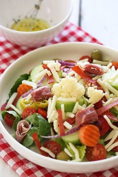 Chopped romaine hearts, shredded mozzarella, olives, prosciutto, turkey pepperoni, roasted red peppers, cucumbers, tomatoes,…