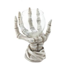 Ghostly glow and scary style will light up your nights when you place a candle inside this eerie candle holder. The detailed skeleton hand rises from your table