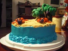 graham cracker cake, cream cheese frosting. oh, and fondant crabs on a beach, carrying heart-shaped coconuts away from palm trees.