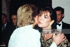 Diana, Princess of Wales, greets Princess Caroline of Monaco on a dinner at the Chateau de Chambord during her official visit to France on November 9, 1988 in Chambord, France.