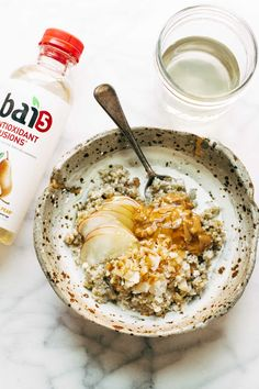 Toasted Coconut Breakfast Porridge - a wholesome and cozy breakfast recipe with quinoa, oats, coconut milk, and one surprise ingredient!   drinkbai, breakfastbybai, AD
