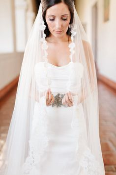 a Bride enveloped in a gorgeous veil | Photography by erinheartscourt.com |   Read more - http://www.stylemepretty.com/2013/07/09/santa-barbara-wedding-from-erin-hearts-court/