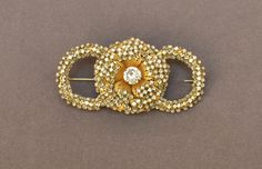 This brooch is a wonderful and rare example of Miriam Haskells early work dating from the 1940s $895