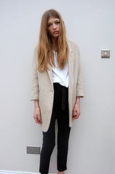 Most horrible photo of a cute girl in expensive clothes ever. She looks so sad and too tired to stand up straight.