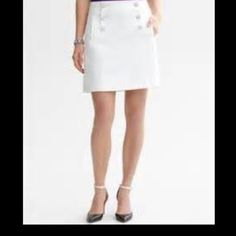 """Banana Republic Sailor Mini Cream color. 6 buttons and 2 pockets in front are for esthetics and are not functional. Back zip. Lined. Wool w Poly/Rayon blend. 18"""" long. Faint piling and a very faint spot as seen in last 2 pics. Cover pic is same skirt with white buttons. Banana Republic Skirts Mini"""