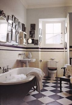 Vintage Bathroom - checkerboard floor tiles, a great old tub and a gallery wall - via Red Bird V
