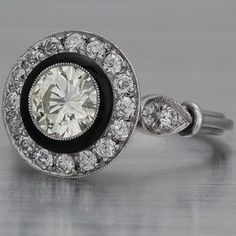 Art Deco Antique ring with diamonds and black enamel.
