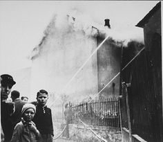 """As the synagogue in Oberramstadt burns during Kristallnacht (the """"Night of Broken Glass""""), firefighters instead save a nearby house. Local residents watch as the synagogue is destroyed. Oberramstadt, Germany, November ~ US Holocaust Memorial Museum Jewish History, World History, Figueras, Burns, Pearl Harbor Attack, Religion, Holocaust Memorial, Lest We Forget, Broken Glass"""