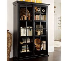 need to find something like this on craigslist! Garrett Glass Cabinet | Pottery Barn