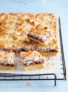 Coconut Raspberry Slice - A winning combination of nostalgic flavours, this classic homemade dessert is an instant crowd-pleaser! Raspberry Coconut Slice, Raspberry Recipes, Coconut Recipes, Chocolate Coconut Slice, Tray Bake Recipes, Baking Recipes, Cake Recipes, Dessert Recipes, Donna Hay Recipes Baking