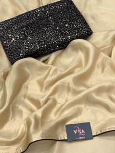 Golden satin crepe saree with designer blouse pc as shown in the pic Raw Silk Saree, Crepe Saree, Satin Saree, Chiffon Saree, Georgette Sarees, Silk Sarees, Patiala Suit, Punjabi Suits, Sari Blouse