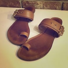 AUTH Tory Buch Toe Ring Sandals BEST FOR SIZE 8-8.5 FEET. RUNS SMALL ‼️ Authentic gently worn as shown in photos. Genuine pebbled Royal tan leather with beautiful gold hardware detailing. In good condition! PRICED ACCORDINGLY AND FIRM. NO BOX. NO TRADES. Tory Burch Shoes Sandals