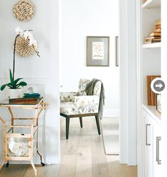 "Beach-Inspired Kitsilano Home (love the ""smoked, scraped white oak floor with a wax treatment""); chair fabric is GP&J Baker's Emperor's Garden in Silver/Grey - by Kelly Deck Design via Style At Home June 2011"