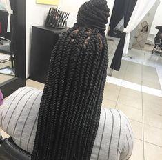 Large box braids. Waist length. Triangular parts
