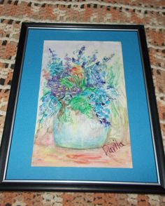 VIEW & PURCHASE @ ETSY @ UINMIND SIMPLY BEAUTIFUL ORIGINAL PASTEL PAINTING OF BLUE BONNETS AND AN ARAY OF OTHER FIELD FLOWERS. FRAMED UNDER GLASS. SIZE OF ART IS 5 3/4 X 9. TOTAL FRAMING IS 9.5 X 12.