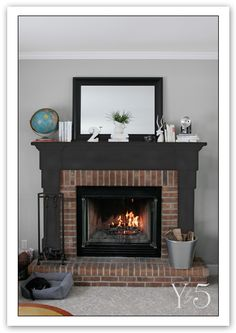 Liking the idea of painting the mantle a darker color than the wall and moulding. Black or really dark grey?