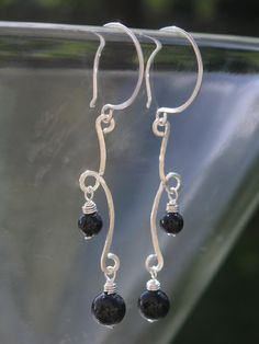 Hammered Silver Scroll & Black Onyx Earrings - Silver Wire Jewelry. $45.00, via Etsy.
