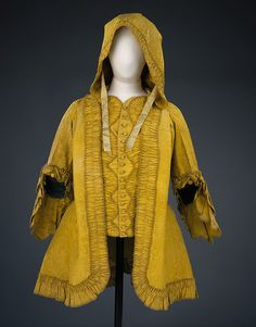 """This garment represents an 18th-century style of jacket known as a Brunswick. A shortened version of the formal sack-back dress, the Brunswick became popular in the 1760s for travelling and informal dress. Although this example has a hood, the very fine watered silk suggests it was intended for casual day wear rather than the rigours of 18th-century travel. Some variations have wrist-length sleeves, and buttons at the elbow of this jacket indicate that it might once have had removable…"