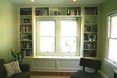 built in bookshelf with window seat