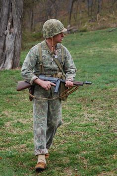 1943 Marine in Camo utilities bearing a M1928 Thompson