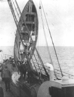 One of Titanic's lifeboats is being drained of water aboard the Carpathia.